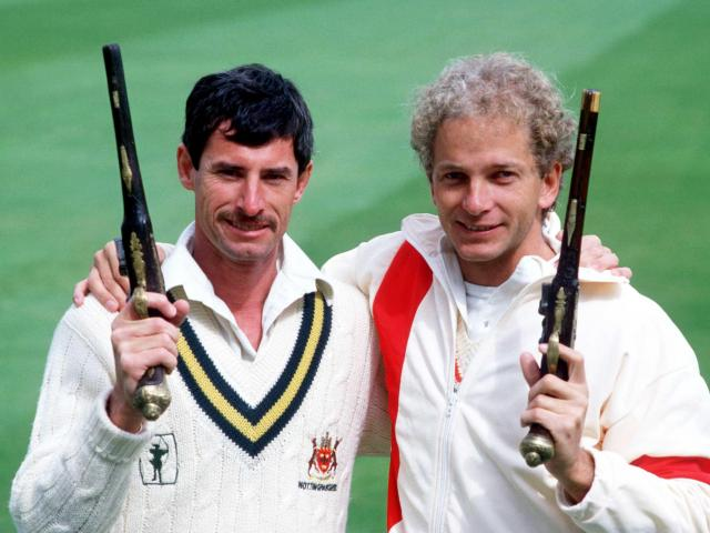 Richard Hadlee and England's David Gower pose with duelling pistols before the first test at Lord...