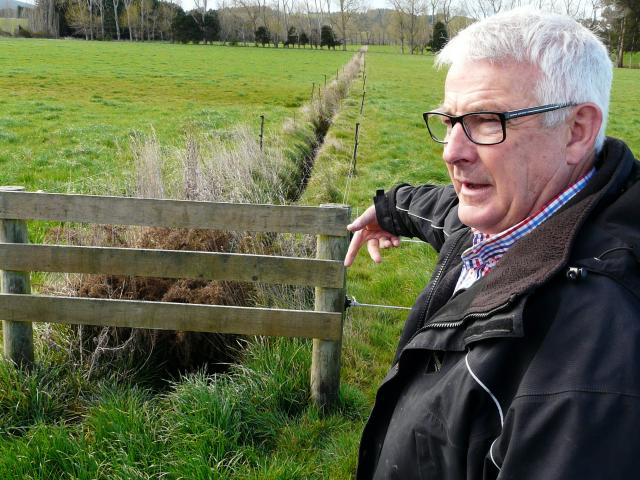 Otago South River Care project manager Lloyd McCall  inspects a dairy paddock ...