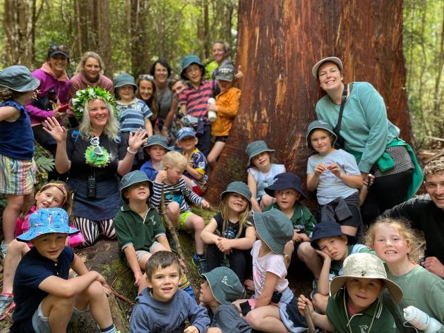 Tahu Mackenzie (left) calls kindergarten pupils visiting Orokonui ...