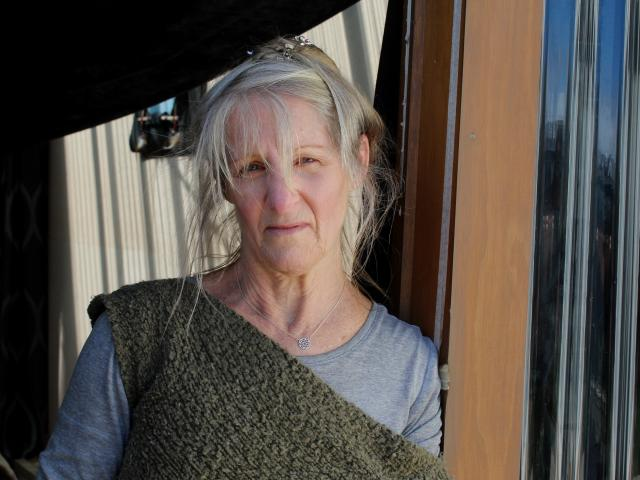Carol Cudby Robinson has sealed cracks in her doors and windows to keep the smell of coal out of...