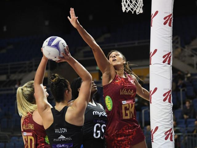 England's Geva Mentor challenges Silver Fern Maia Wilson for the ball during the second test in...