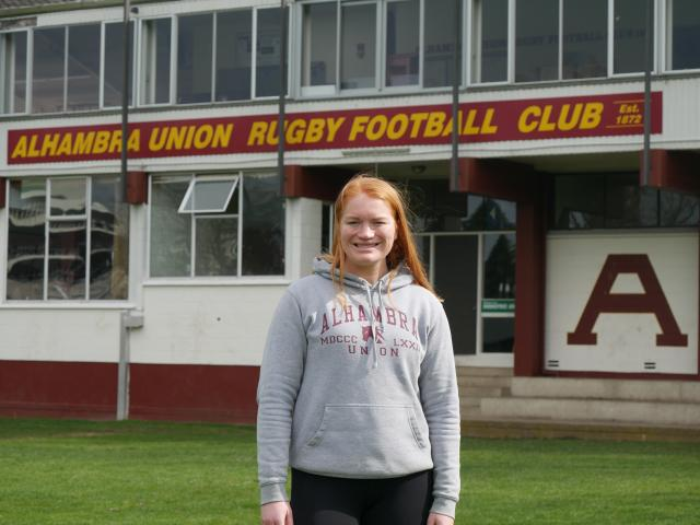 Alhambra-Union Rugby Football Club committee member and player Katie Hensman stands in front of...