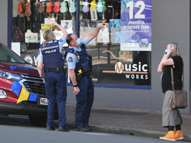 Police at the scene, outside the Department of Corrections office building, in Stuart St. Photo:...