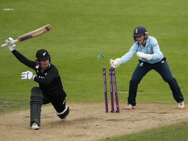 New Zealand's Brooke Halliday is stumped by England's Amy Jones off the bowling of Charlotte Dean...