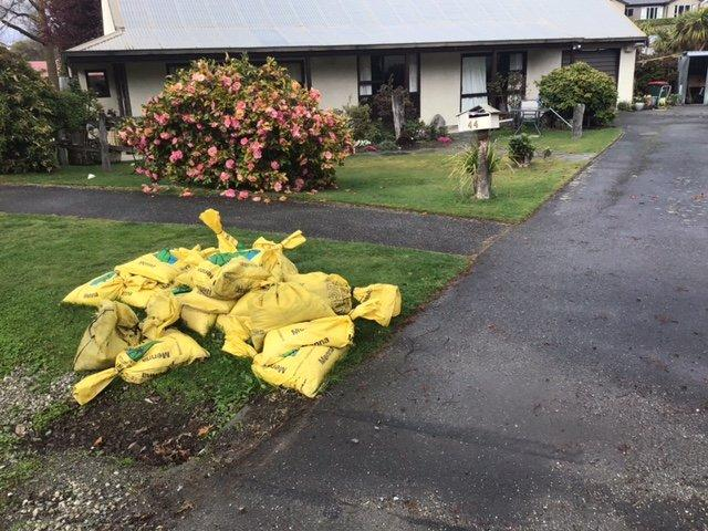 Queenstown Lakes District Council-supplied sandbags outside Val McMillan's Arrowtown home to help...
