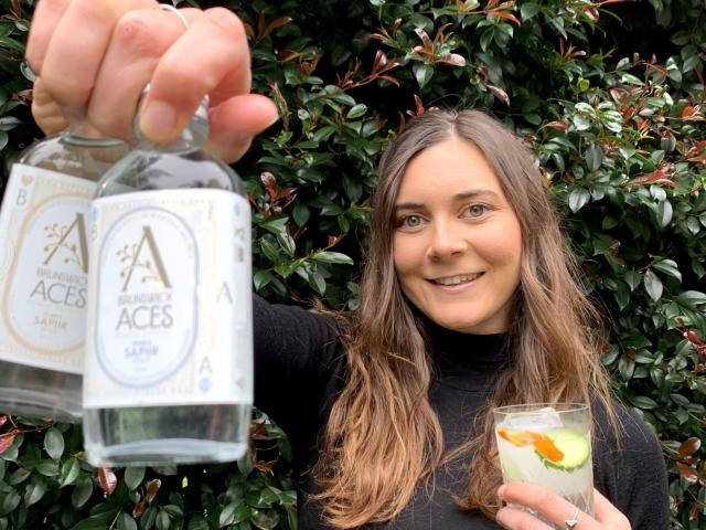 Sophie Williamson with her company's alcohol-free ''gin''. PHOTO: SUPPLIED