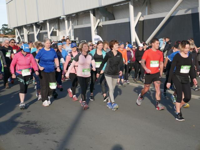 And they're off . . . Half marathon walkers set off at the start of the Dunedin Marathon, held in...