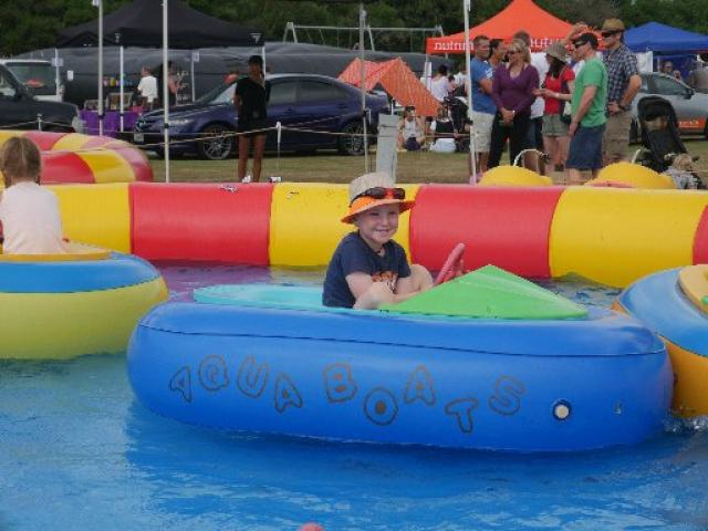 Floating by...Fabian Weir (then 5), of Fairfield, plays in an aqua boat at the Brighton Gala Day...