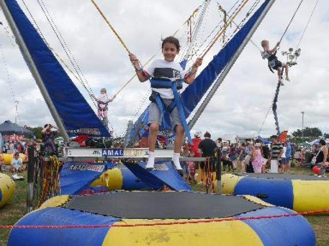 High flyer...Armani Ngaia (then 6), of Brighton, bounces on the Amac Bungy at last year's gala...