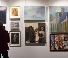 Janet Farquharson, of Dunedin, admires artwork at the Edinburgh Realty Premier Art Awards...