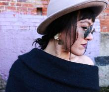Kristina wear a Witchery mohair jumper $199, Lovisa earrings $15.99 and her own hat and...