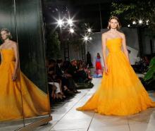 Herrera stayed true to her glamorous and feminine silhouettes, bright hues of red, iris and yellow. Photo: Reuters