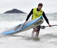 Surf ski event winner Andrew Newton, formerly of St Clair but now of Tauranga, arrives back on the beach. Photos: Peter McIntosh