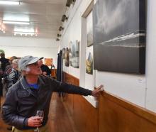 Dunedin artist and exhibition judge Barry Weston looks at photographic work Allans Beach Storm, by John Burke. Photos: Peter McIntosh