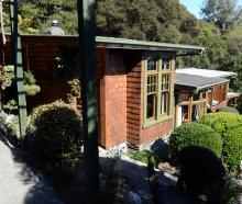 Owners Ian Melvin and Helga Diettrich have added to their 1950s cottage as time and money allowed...