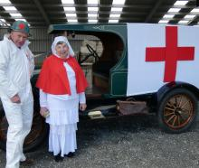 Angus and Elaine Petrie, of Bluff, show their 1918 Model T Ford dressed up as a medical vehicle...