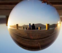 Jordan and Cameron Dargaville watch the sun set at Harwood on Christmas Day. The photo was taken through a lens ball. Photo: Browyn Dargaville