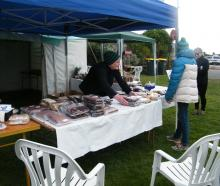 Little Rakaia Boating Club treasurer Kate Patterson sets out fresh baking to sell to gala-goers.