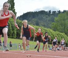 The first leg of an under-13 girls 200m relay heat. PHOTOS: GERARD O'BRIEN