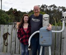 Kevin Hutt hugs his wife Karen Hutt and a letterbox out the front of their home in Harwood.  PHOTOS: SHAWN MCAVINUE