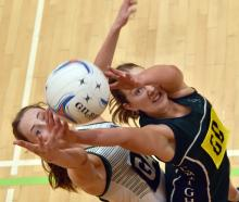 Columba College goal attack Harriett Cuttence (17) (left) looks to grab the ball ahead of...