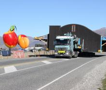 The main part of the former The Nose restaurant passes the big fruit at Cromwell yesterday on its...