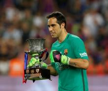 Claudio Bravo celebrates with the Spanish SuperCup trophy. Photo: Reuters