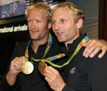Eric Murray and Hamish Bond after returning to New Zealand with their gold medals from Rio. Photo...