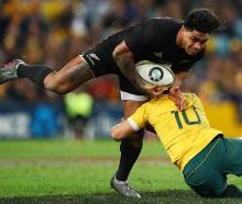 Malakai Fekitoa attempts to run over Bernard Foley during the All Blacks' win. Photo: Getty Images