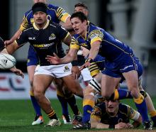 Otago halfback Josh Walden clears the ball from a ruck. Photo: Getty Images
