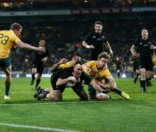 Israel Dagg scores for the All Blacks against the Wallabies. Photo: Getty Images