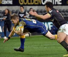 Wellington fullback Peter Umaga-Jensen is unable to stop Otago fullback Michael  Barr Stadium...