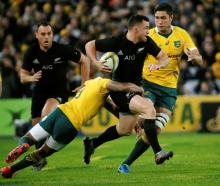 Ryan Crotty runs with the ball for the All Blacks against Australia. Photo: Reuters