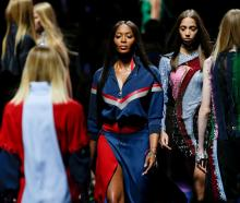 Naomi Campbell presents a creation at the Versace fashion show during Milan Fashion Week. Photo...
