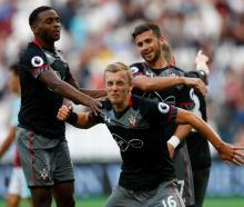 Southampton's James Ward-Prowse celebrates scoring their third goal against West Ham. Photo:...