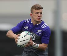 Damian McKenzie runs the ball during a New Zealand All Blacks training session earlier this month...
