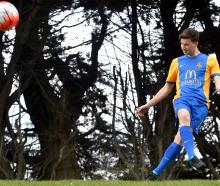 Southern United youth team player Riley Anderton (19) shows off the side's new strip at Tahuna...