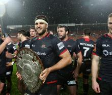 Canterbury captain Luke Whitelock (C) holds the Ranfurly Shield after the round seven Mitre 10...