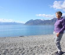 Guardians of Lake Hawea chairwoman Barbara Chinn stands where she believes the level was at this...