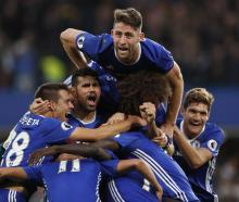 Chelsea players celebrate their fourth goal against Manchester United. Photo Reuters