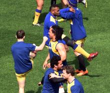 The Otago team warms up at training at Forsyth Barr Stadium yesterday. Photo: Peter McIntosh.