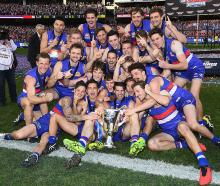 The Western Bulldogs celebrate with the trophy. Photo: Getty Images