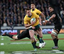 Australia's Dane Haylett-Petty runs the ball up against the All Blacks at Eden Park. Photo Getty