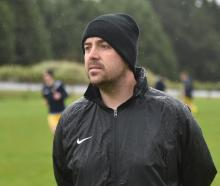 Southern United coach Paul O'Reilly oversees proceedings during team training at Forrester Park...
