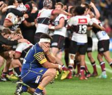 Otago prop Josh Hohneck turns away in disbelief as North Harbour celebrates victory in the...