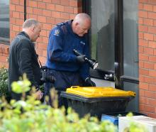 Police inspect a Dunedin house yesterday from which firearms were stolen on Tuesday. Photo by...