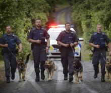 Dunedin police dog section members finding strength in numbers are (from left) Senior Constable...