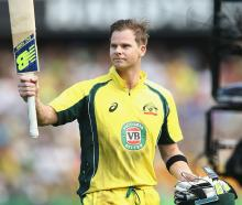 Australia's Steve Smith acknowledges the crowd as he leaves the field after scoring 164 against...