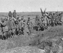 German prisoners coming back from Morval in France, carrying British wounded. — Otago Witness, 13...