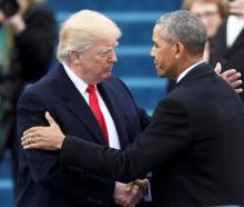 Outgoing President Barack Obama (R) greets President-elect Donald Trump before the inauguration...